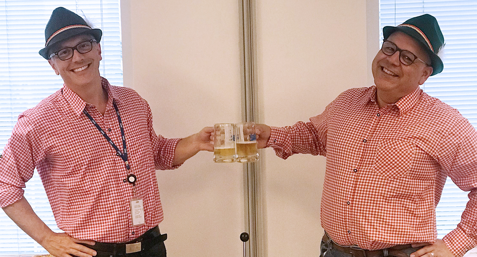Josh Jackson and Mark Escobar celebrate Oktoberfest, one of the larger fundraisers organized by SAIC employees.