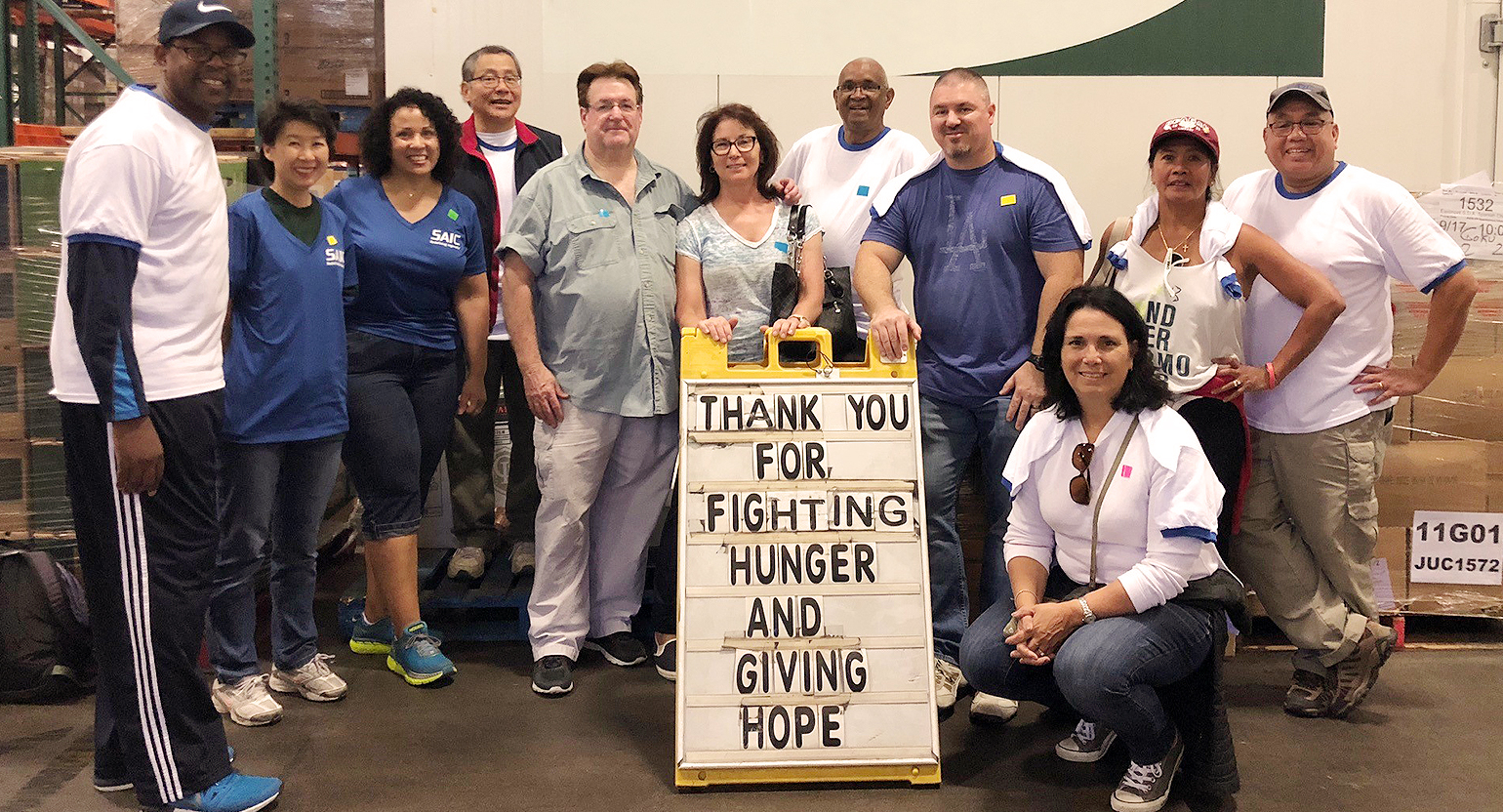 Employees volunteer at the Los Angeles regional food bank.