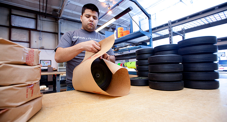 An SAIC employee in Chambersburg, PA, works on a logistic project, packaging and shipping tires.