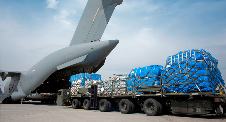 loading a plane with a truck load of supplies and packages