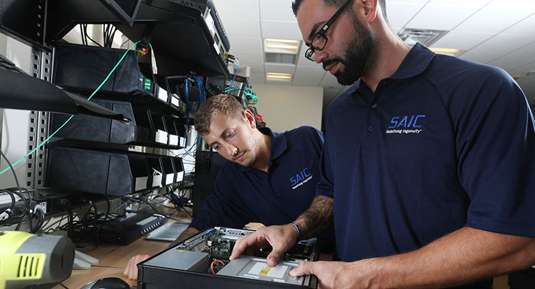 Two SAIC engineers are assembling the computer