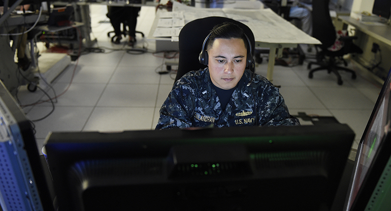A service member participating in fleet synthetic training remotely.
