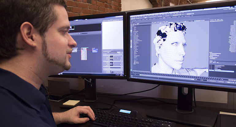 An SAIC character modeler, Joel Ryan, works on a design at his workstation.