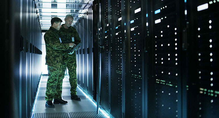In Data Center Two Military Men Work with Open Server Rack Cabinet.